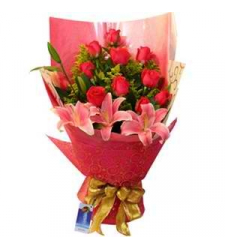 12 red roses with 3 lilys in bouquet to cebu